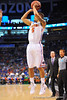 Florida guard Scottie Wilbekin launches his first three point attempt of the game and drains the bucket.  Florida Gators vs Pitt Panthers.  March 22nd, 2014.  Gator Country photo by David Bowie.
