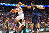 Florida guard Scottie Wilbekin drives to the basket and scores on a remarkable shot.  Florida Gators vs Pitt Panthers.  March 22nd, 2014.  Gator Country photo by David Bowie.