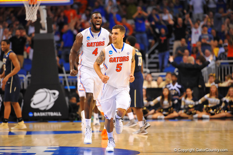 Florida guard Scottie Wilbekin is all smile after draining a 3-pointer with no time left on the clock in the first half.  Florida Gators vs Pitt Panthers.  March 22nd, 2014.  Gator Country photo by David Bowie.