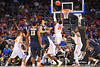 Florida guard Michael Frazier leaps up for the rebound as he pulls it in over Pitt guard Cameron Wright.  Florida Gators vs Pitt Panthers.  March 22nd, 2014.  Gator Country photo by David Bowie.