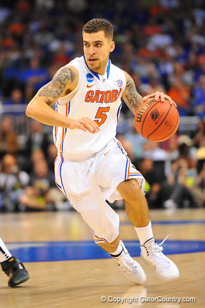 Florida guard Scottie Wilbekin dribbles up court in the first half.  Florida Gators vs Pitt Panthers.  March 22nd, 2014.  Gator Country photo by David Bowie.