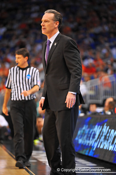 Pitt head coach Jamie Dixon watches on from the sidelines.  Florida Gators vs Pitt Panthers.  March 22nd, 2014.  Gator Country photo by David Bowie.