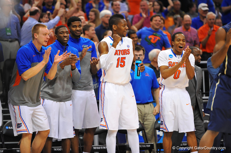 The Gator bench cheers on as the Gators begin to extend their lead.  Florida Gators vs Pitt Panthers.  March 22nd, 2014.  Gator Country photo by David Bowie.