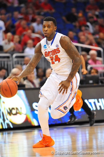 Florida forward Casey Prather dribbles up court in the second half.  Florida Gators vs Pitt Panthers.  March 22nd, 2014.  Gator Country photo by David Bowie.