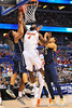 Florida center Patric Young fights for the offensive rebound.  Florida Gators vs Pitt Panthers.  March 22nd, 2014.  Gator Country photo by David Bowie.