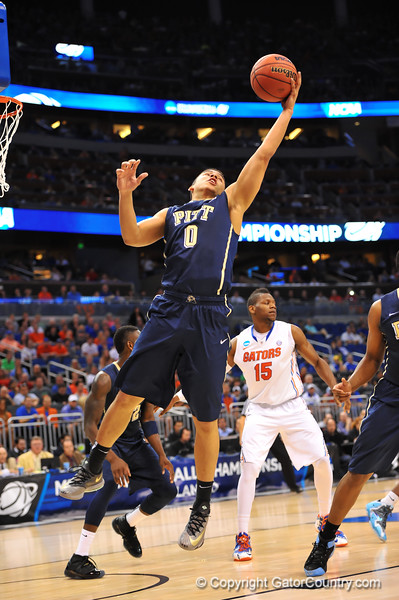 Pitt guard James Robinson leaps up for the rebound in the first half.  Florida Gators vs Pitt Panthers.  March 22nd, 2014.  Gator Country photo by David Bowie.