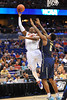 Florida forward Will Yeguete leaps and over the extending arms of Pitt forward Michael Young for the shot attempt.  Florida Gators vs Pitt Panthers.  March 22nd, 2014.  Gator Country photo by David Bowie.