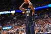 Pitt forward Michael Young launches a three pointer late in the first half.  Florida Gators vs Pitt Panthers.  March 22nd, 2014.  Gator Country photo by David Bowie.