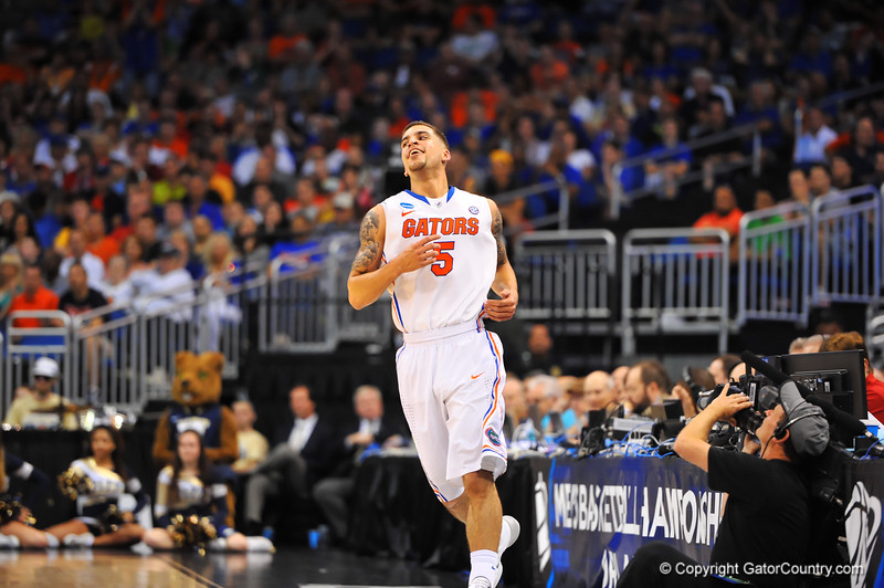 Florida guard Scottie Wilbekin smiles as he is called for a foul he disagreed with during the second half.  Florida Gators vs Pitt Panthers.  March 22nd, 2014.  Gator Country photo by David Bowie.