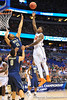 Florida forward Casey Prather puts up the floater over Pitt forward Derrick Randall.  Florida Gators vs Pitt Panthers.  March 22nd, 2014.  Gator Country photo by David Bowie.
