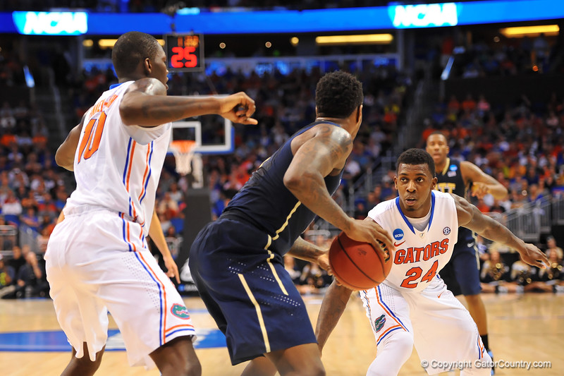 Florida forward Casey Prather comes up to help Florida forward Dorian Finney-Smith apply the full court press.  Florida Gators vs Pitt Panthers.  March 22nd, 2014.  Gator Country photo by David Bowie.