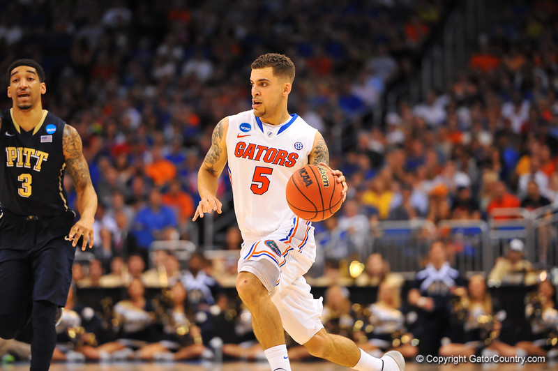 Florida guard Scottie Wilbekin drives up court in the second half.  Florida Gators vs Pitt Panthers.  March 22nd, 2014.  Gator Country photo by David Bowie.