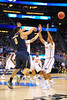 Gators Scottie Wilbekin and Kasey Hill apply the full court press to Pitt guard James Robinson.  Florida Gators vs Pitt Panthers.  March 22nd, 2014.  Gator Country photo by David Bowie.