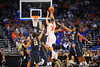 Florida guard Scottie Wilbekin drains a running 3-pointer with no time left on the clock in the first half.  Florida Gators vs Pitt Panthers.  March 22nd, 2014.  Gator Country photo by David Bowie.
