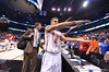 Gator Scottie Wilbekin gator chomps as he walks off the court following their victory.  Florida Gators vs Pitt Panthers.  March 22nd, 2014.  Gator Country photo by David Bowie.