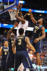 Florida center Patric Young leaps up and slams the ball in while being surrounded by the Pitt defense.  Florida Gators vs Pitt Panthers.  March 22nd, 2014.  Gator Country photo by David Bowie.