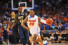 Florida guard Michael Frazier dribbles up court and toward the basket in the second half.  Florida Gators vs Pitt Panthers.  March 22nd, 2014.  Gator Country photo by David Bowie.