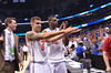 Gators Scottie Wilbekin and Will Yeguete gator chomp as they walk off the court.  Florida Gators vs Pitt Panthers.  March 22nd, 2014.  Gator Country photo by David Bowie.