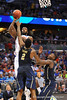 Florida center Patric Young leaps up and over Pitt forward Michael Young to take the shot.  Florida Gators vs Pitt Panthers.  March 22nd, 2014.  Gator Country photo by David Bowie.