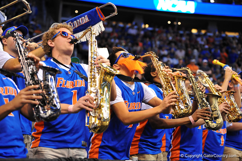 The Florida Gator band plays on during a timeout in the first half.  Florida Gators vs Pitt Panthers.  March 22nd, 2014.  Gator Country photo by David Bowie.