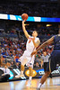 Florida guard Scottie Wilbekin drives the lane and puts up a floater that goes in.  Florida Gators vs Pitt Panthers.  March 22nd, 2014.  Gator Country photo by David Bowie.