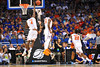 Florida center Patric Young leaps up and blocks the shot attempt by Pitt forward Derrick Randall.  Florida Gators vs Pitt Panthers.  March 22nd, 2014.  Gator Country photo by David Bowie.