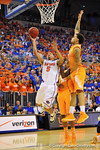 Florida guard Scottie Wilbekin drives past the Tennessee defense and puts up the shot.  Florida Gators vs Tennessee Volunteers.  January 25, 2013.  Gator Country photo by David Bowie.