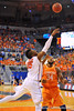 Florida forward Will Yeguete puts a floater in the second half.  Florida Gators vs Tennessee Volunteers.  January 25, 2013.  Gator Country photo by David Bowie.