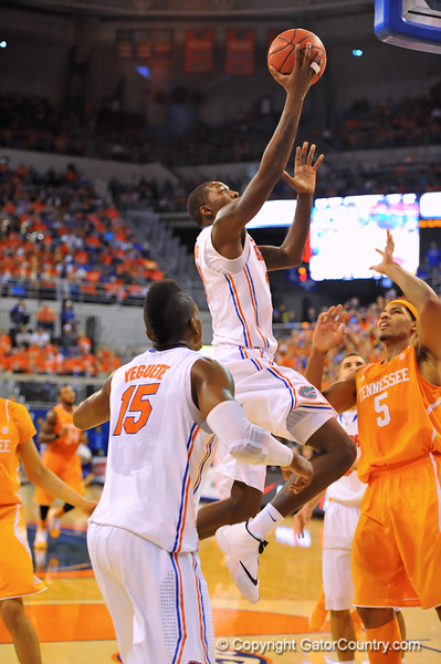 Florida forward Dorian Finney-Smith drives to the net and lays in the bucket.  Florida Gators vs Tennessee Volunteers.  January 25, 2013.  Gator Country photo by David Bowie.