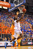 Florida center Patric Young drives past Tennessee forward Jarnell Stokes for the reverse lay-up.  Florida Gators vs Tennessee Volunteers.  January 25, 2013.  Gator Country photo by David Bowie.
