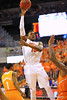 Florida forward Will Yeguete turns and puts up the floater during the second half.  Florida Gators vs Tennessee Volunteers.  January 25, 2013.  Gator Country photo by David Bowie.