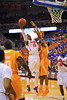 Florida forward Will Yeguete puts up the right handed shot.   Florida Gators vs Tennessee Volunteers.  January 25, 2013.  Gator Country photo by David Bowie.