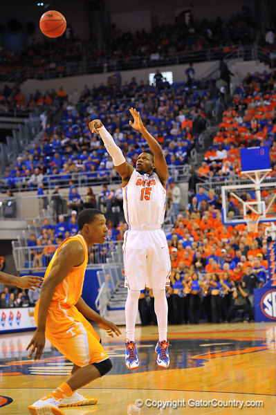 Florida forward Will Yeguete puts up the 3-point shot attempt in the first half.  Florida Gators vs Tennessee Volunteers.  January 25, 2013.  Gator Country photo by David Bowie.