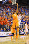 Tennessee forward Jarnell Stokes and Florida center Patric Young fight for a rebound.  Florida Gators vs Tennessee Volunteers.  January 25, 2013.  Gator Country photo by David Bowie.