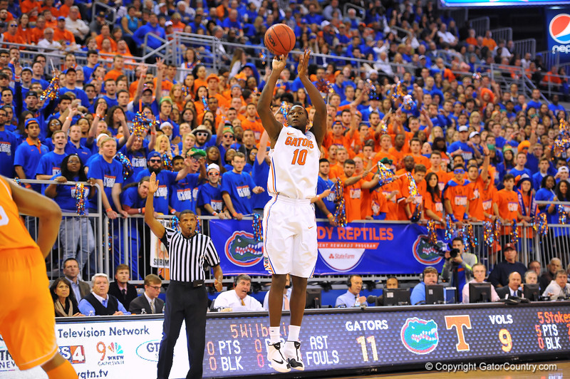 Florida forward Dorian Finney-Smith drains a 3-pointer in the first half.  Florida Gators vs Tennessee Volunteers.  January 25, 2013.  Gator Country photo by David Bowie.