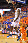 Florida center Patric Young slams the ball in off the alley-oop.  Florida Gators vs Tennessee Volunteers.  January 25, 2013.  Gator Country photo by David Bowie.