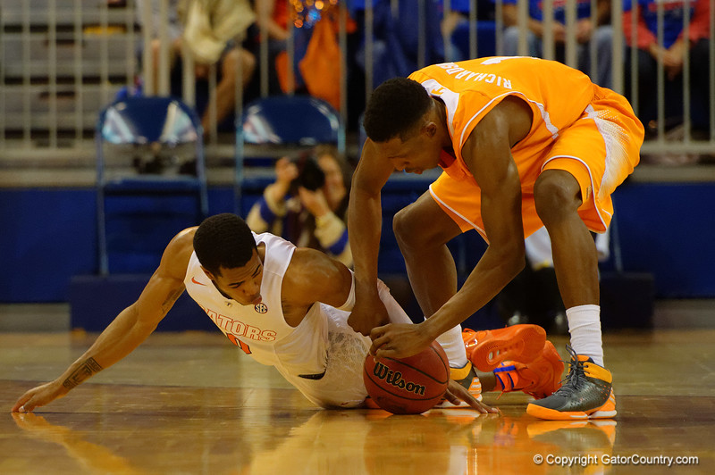 Florida Gators guard Kasey Hill and Tennessee Volunteers forward Armani Moore fight for a loose ball during the second half.  Florida Gators vs Tennessee Vols.  February 28th, 2015. Gator Country photo by David Bowie.
