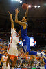Kentucky Wildcats forward Willie Cauley-Stein posterizes Florida Gators forward Devin Robinson with a massive dunk during the second half.  Florida Gators vs Kentucky Wildcats.  February 7th, 2015. Gator Country photo by David Bowie.
