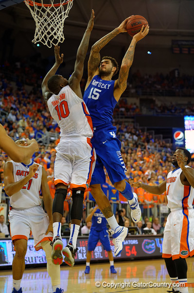Kentucky Wildcats forward Willie Cauley-Stein leaps up and scores over Florida Gators forward Dorian Finney-Smith during the second half.  Florida Gators vs Kentucky Wildcats.  February 7th, 2015. Gator Country photo by David Bowie.