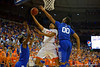 Florida Gators forward Devin Robinson drives to the basket and lays the ball in over Kentucky Wildcats forward Marcus Lee in the first half.  Florida Gators vs Kentucky Wildcats.  February 7th, 2015. Gator Country photo by David Bowie.
