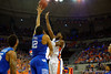 Florida Gators guard Eli Carter with a shot attempt over Kentucky Wildcats forward Karl-Anthony Towns in the first half.  Florida Gators vs Kentucky Wildcats.  February 7th, 2015. Gator Country photo by David Bowie.