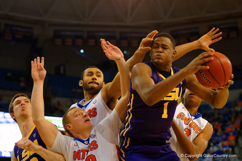 LSU Tigers forward Jarell Martin leaps into the air over three Gators for a rebound in the second half.  Florida Gators vs LSU Tigers.  January 20th, 2015. Gator Country photo by David Bowie.