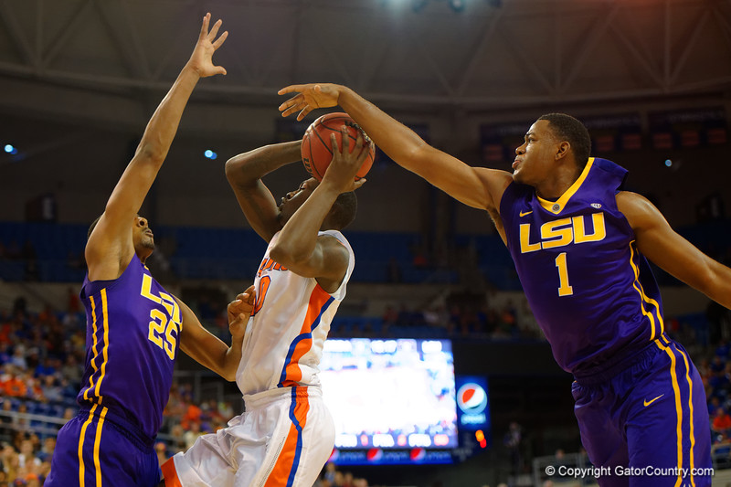 Florida Gators forward Dorian Finney-Smith has hit shot blocked by LSU Tigers forward Jarell Martin during the first half.  Florida Gators vs LSU Tigers.  January 20th, 2015. Gator Country photo by David Bowie.