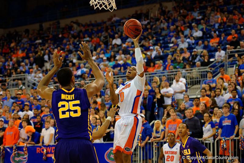Florida Gators guard Kasey Hill throws up a shot attempt late in the second half.  Florida Gators vs LSU Tigers.  January 20th, 2015. Gator Country photo by David Bowie.