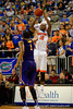 Florida Gators forward Dorian Finney-Smith with a three point shot attempt in the second half.  Florida Gators vs LSU Tigers.  January 20th, 2015. Gator Country photo by David Bowie.