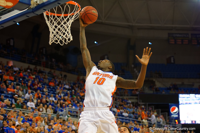 Florida Gators forward Dorian Finney-Smith lays in a basket during the first half.  Florida Gators vs LSU Tigers.  January 20th, 2015. Gator Country photo by David Bowie.