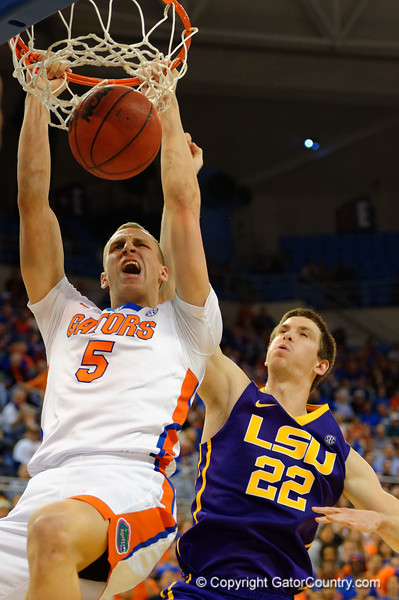 Florida Gators forward Alex Murphy with a slam dunk past LSU Tigers center Darcy Malone in the first half.  Florida Gators vs LSU Tigers.  January 20th, 2015. Gator Country photo by David Bowie.