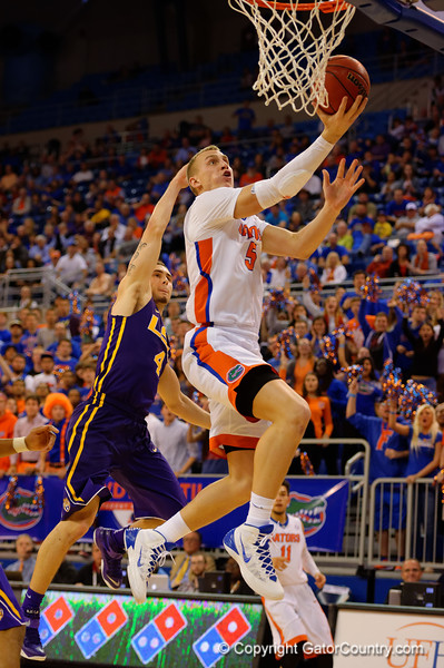 Florida Gators forward Alex Murphy with a lay up past LSU Tigers guard Keith Hornsby during the second half.  Florida Gators vs LSU Tigers.  January 20th, 2015. Gator Country photo by David Bowie.