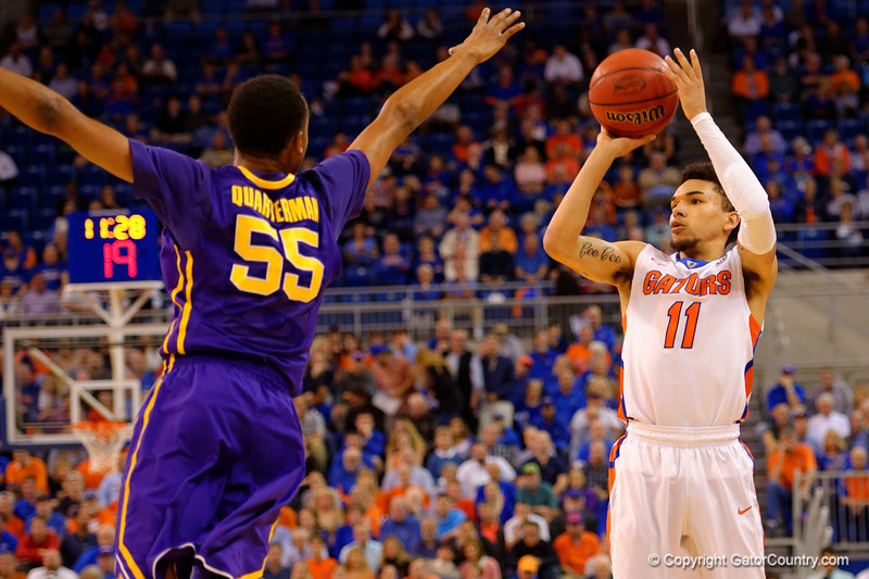 Florida Gators guard Chris Chiozza gets away a three point attempt just a LSU Tigers guard Tim Quarterman leaps in for the block.  Florida Gators vs LSU Tigers.  January 20th, 2015. Gator Country photo by David Bowie.