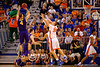 Florida Gators forward Jacob Kurtz stretches trying to contest the shot by LSU Tigers guard Keith Hornsby.  Florida Gators vs LSU Tigers.  January 20th, 2015. Gator Country photo by David Bowie.